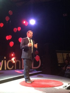 Justin speaking at a TEDx event
